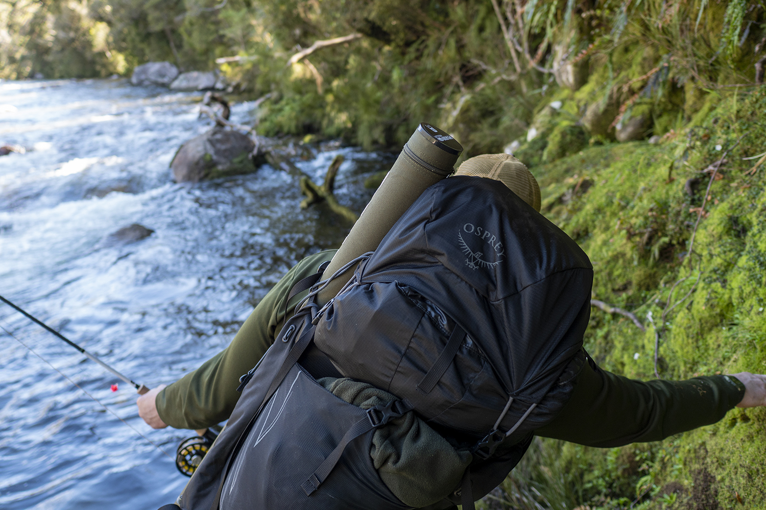 Dave Grieg fishing with an Osprey Aether pack